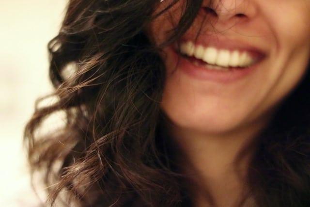 half face woman smile pexels-photo-87346